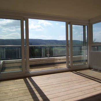 Bi-folding doors & balcony - Dobson Building Contractors, Yorkshire