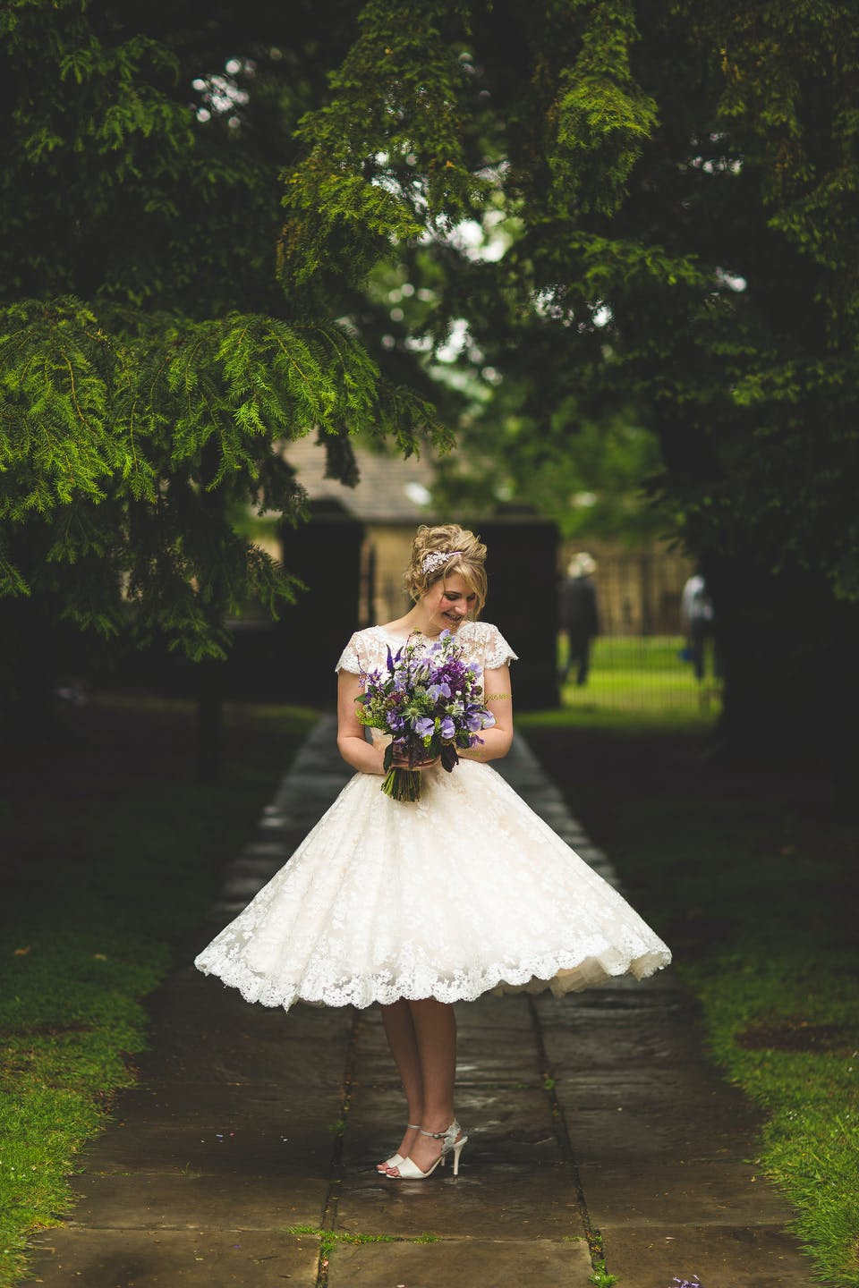 Beautiful Becky in her stunning tea-length wedding dress at romantic Yorkshire venue Nostell Priory