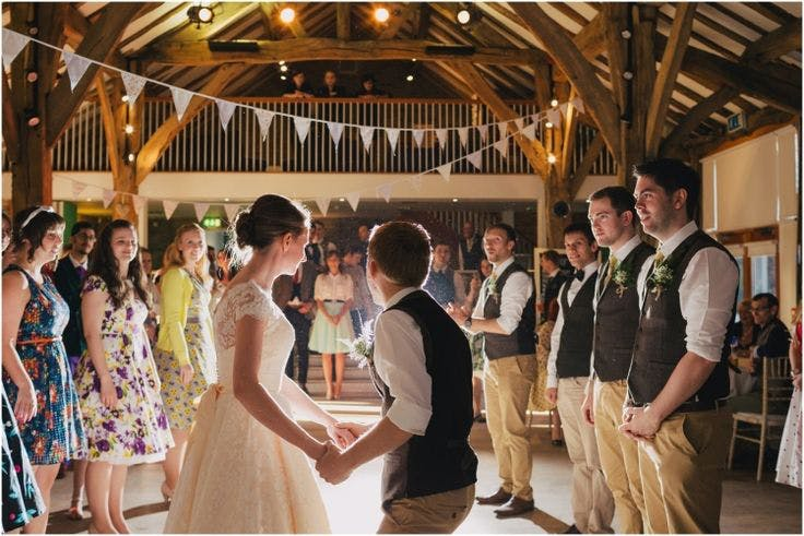 Beautiful rustic barn wedding, with dapper groom and sack races and Cris wearing her stunning tea-length wedding dress, Sarah by House of Mooshki. Images by Stott + Atkinson