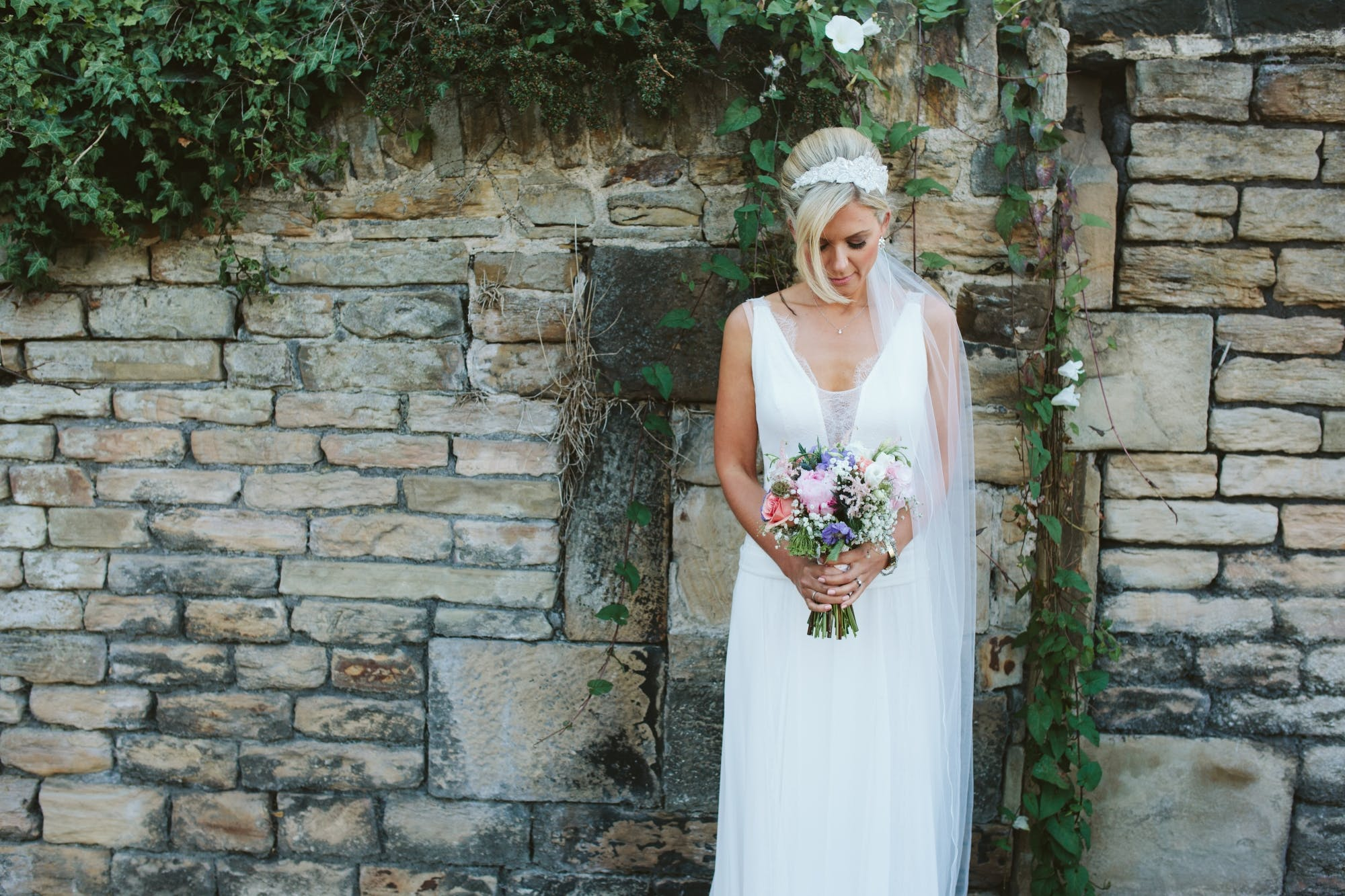 Our bohemian style bride Emma looking effortlessly beautiful in her dress 'Daphne' by Rembo Styling