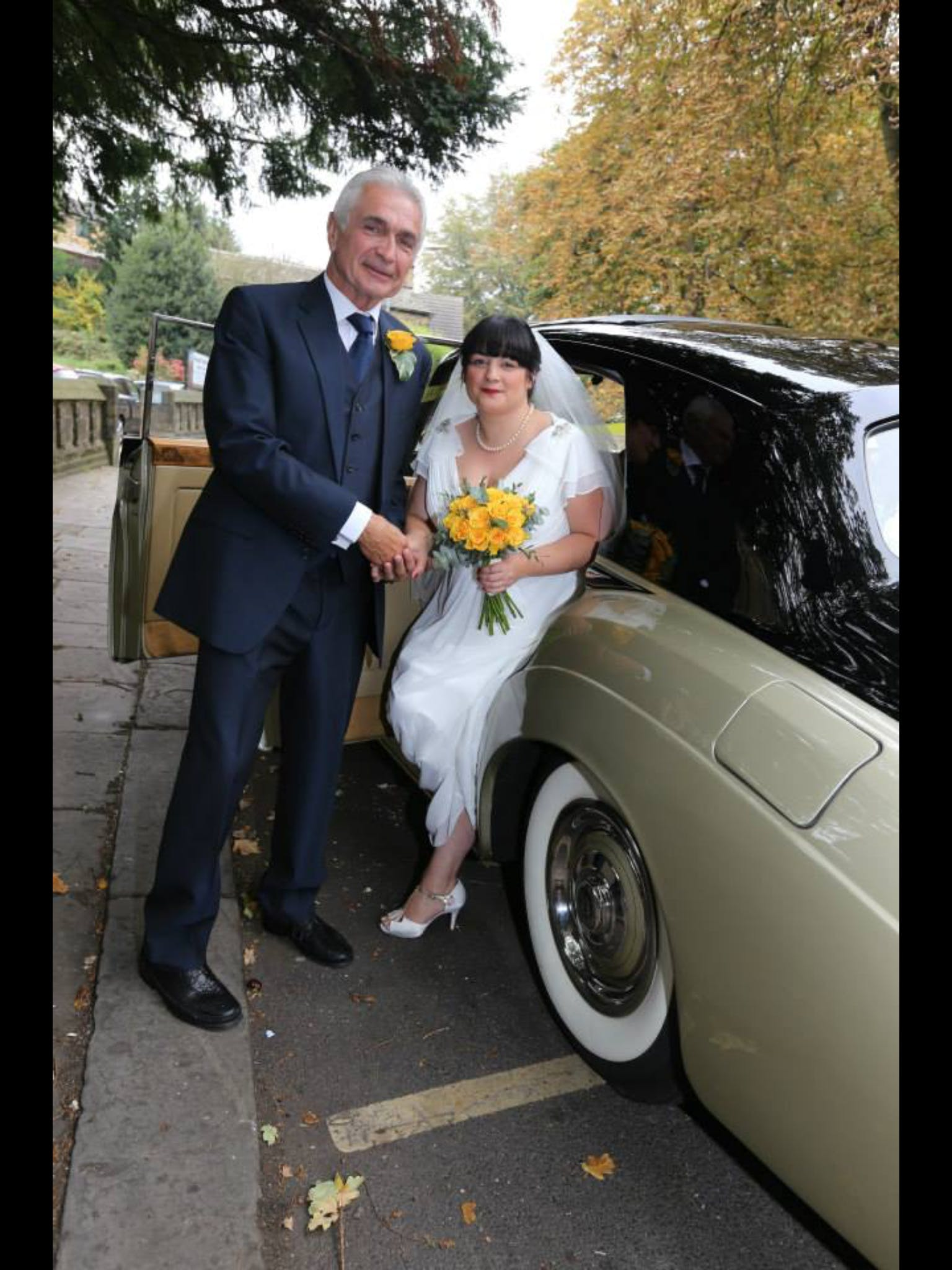 Hannah wore beautiful Gatsby style dress, Lady Mary, and matched it with incredible yellow flowers by Blackburn Florist.