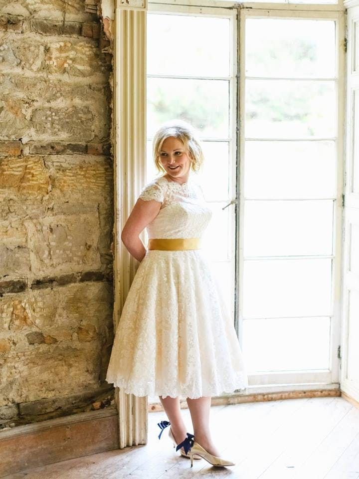 Laura in her beautiful vintage-inspired tea-length wedding dress. She actually danced her way down the aisle!