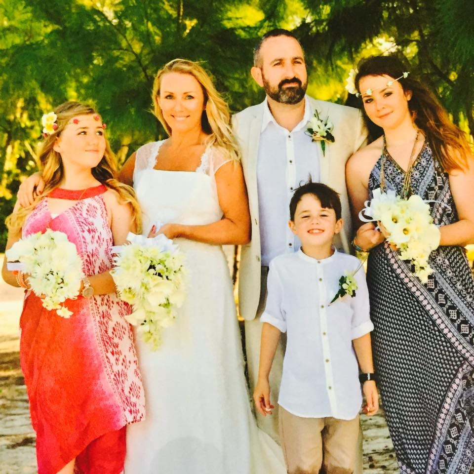 Our beautiful boho bride Louise wearing 'Maya' by Rembo Styling and looking so happy and content with her gorgeous family