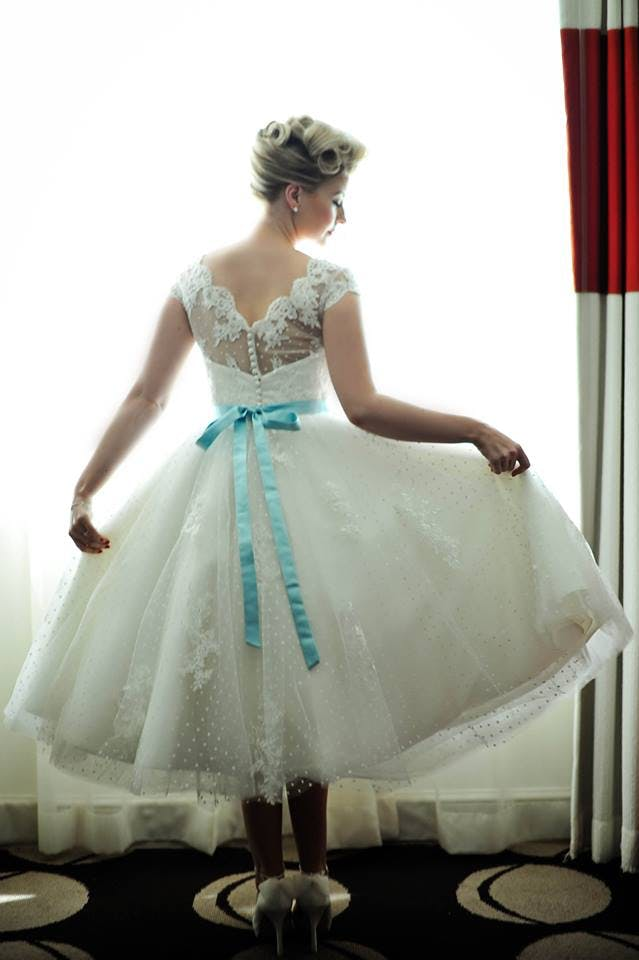 Bride Vicky was lucky enough to wear her dress twice, at her incredible Las Vegas wedding and again at her UK reception. She matched her calf-length dress with a duck egg blue sash and fantastic shoes