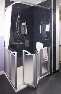 new safe & practical level access shower solution area in our showroom