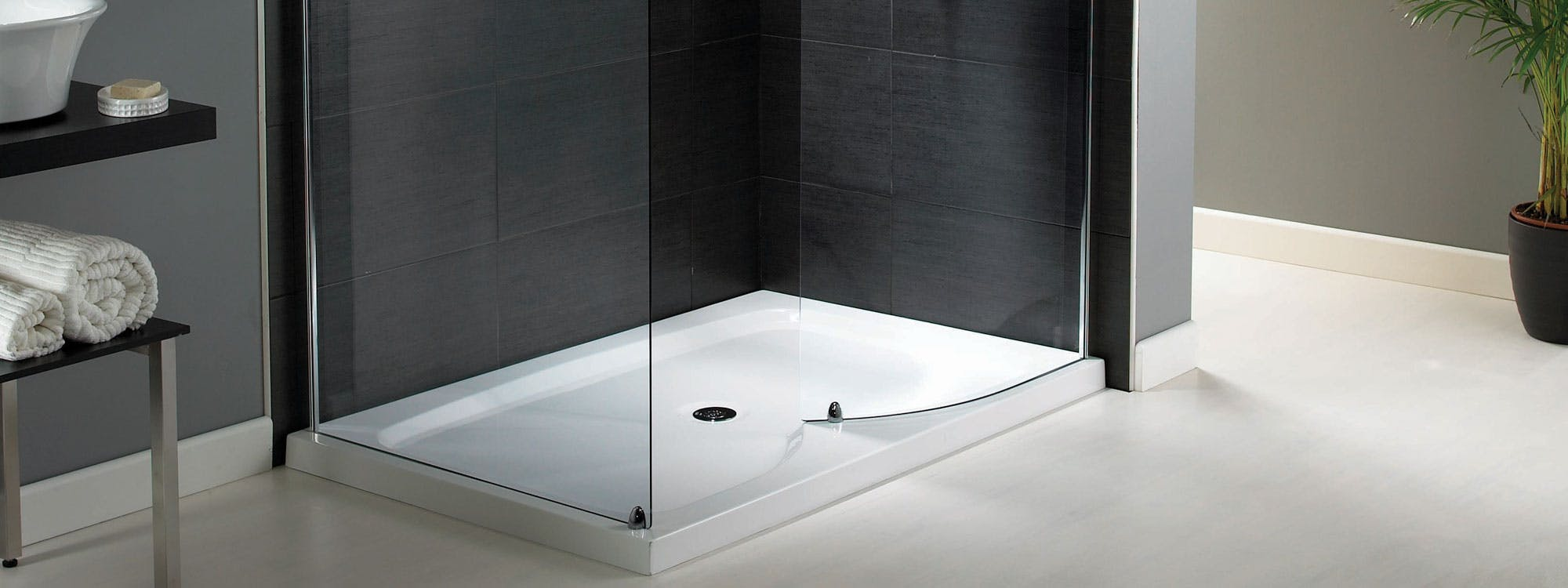 As with all accessible showering & bathing solutions the finishing touches to the overall suite is key to ensuring a stylish design, curved glass screens, chrome mixers and additional safe accessories are a accessible shower must.