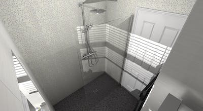 A safe and accessible wet floor shower room, and adjoining WC, designed & installed by More Ability.