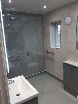 an easy access shower room renovation and creation of an en-suite bathroom, fully project managed from concept to completion