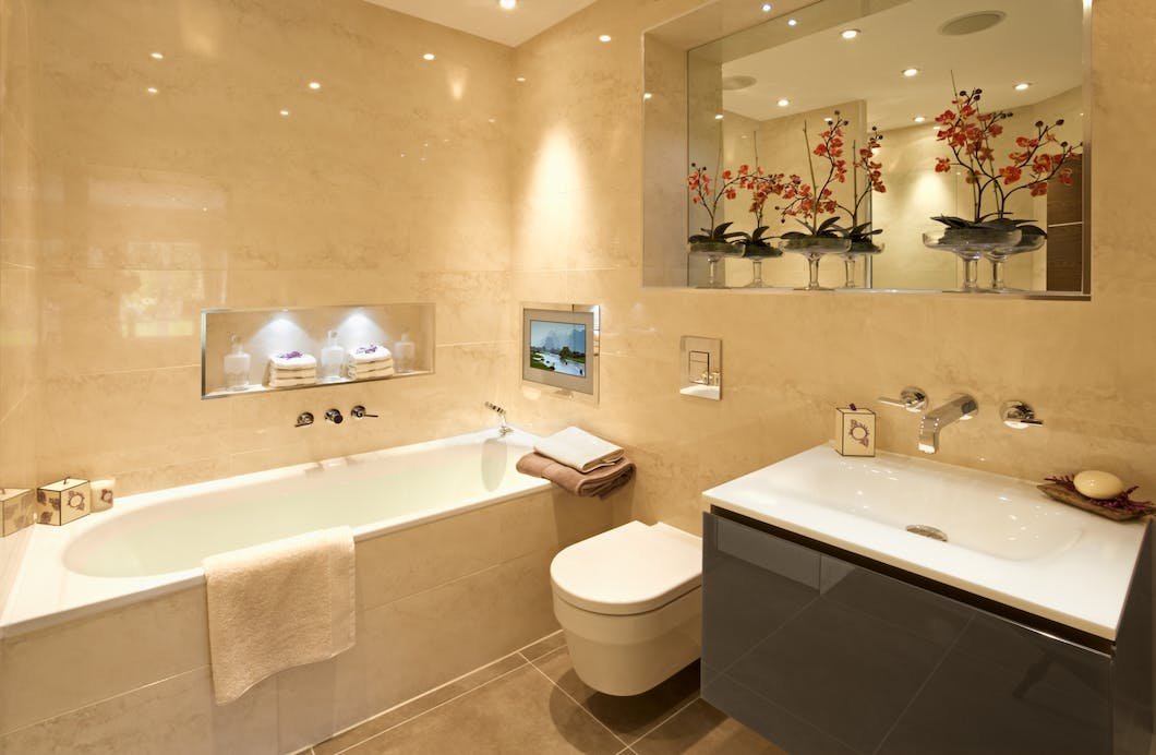 Warm bathroom lighting is preferable where a beige and brown coloured suite is favoured as it helps to create a softer, warmer and cosier feel.