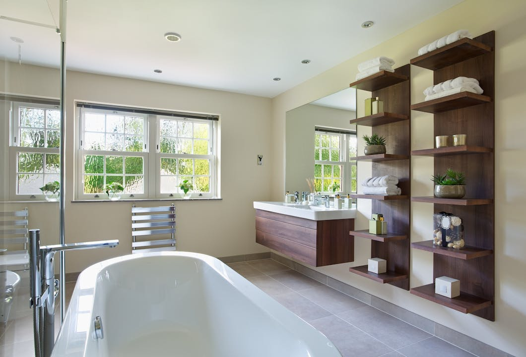 Another bathroom storage option is modular furniture, a modern day, more economical twist, on the back-to-wall design.​