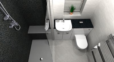 A large walk-in shower refurbishment with stylish corian seating area and a run of fitted furniture transformed an existing bathroom into a space enhanced shower room.