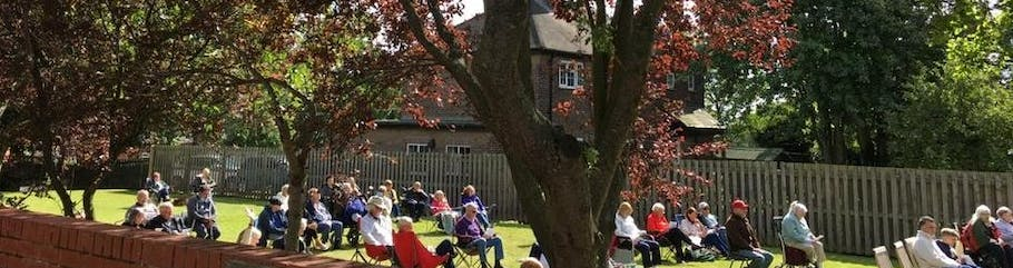 Sunday worship on the Church Lawn