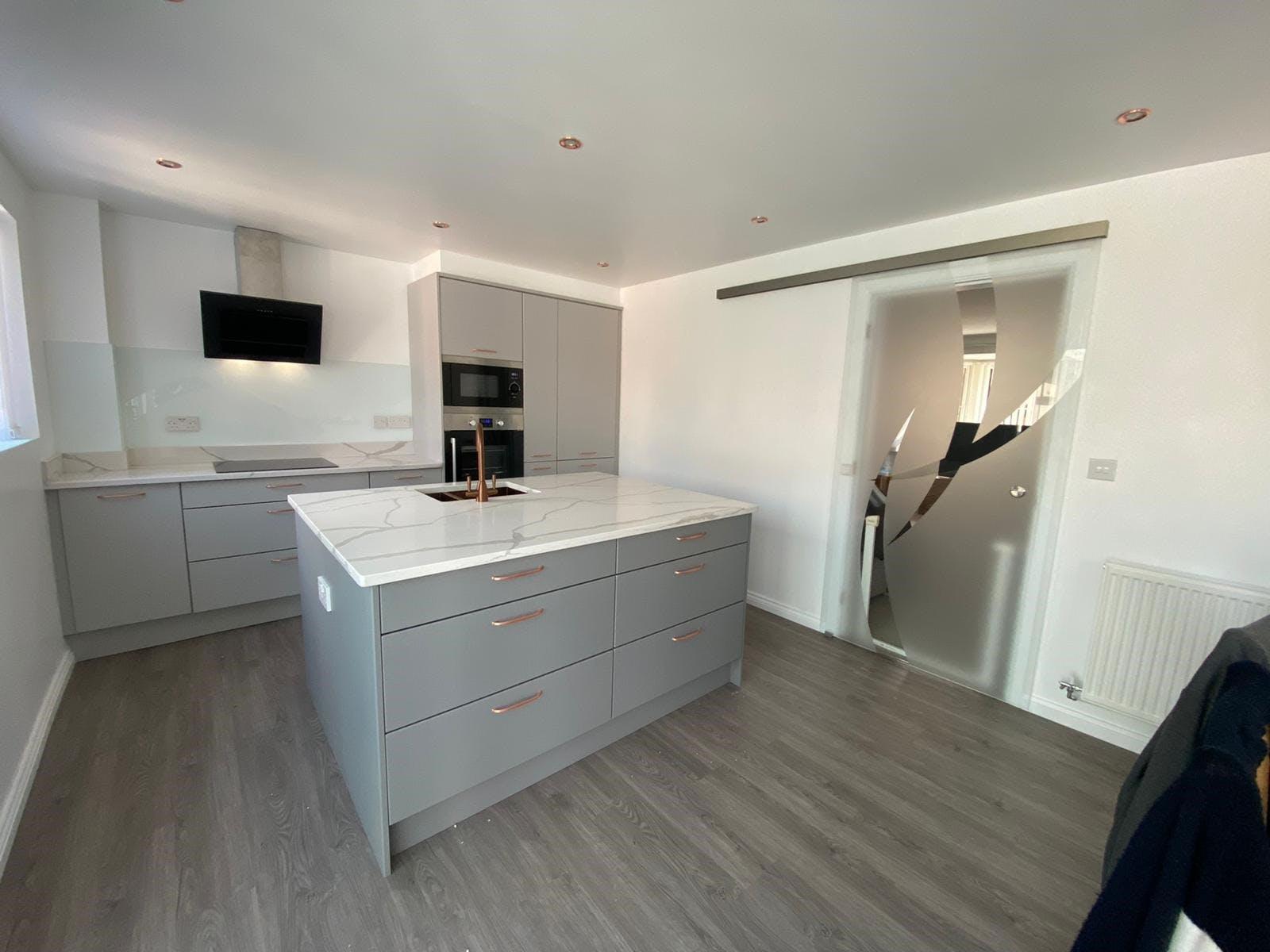 Get Slab Kitchen Island With Calacatta Quartz Worktop and Bespoke Sliding Glass Door Sheffield