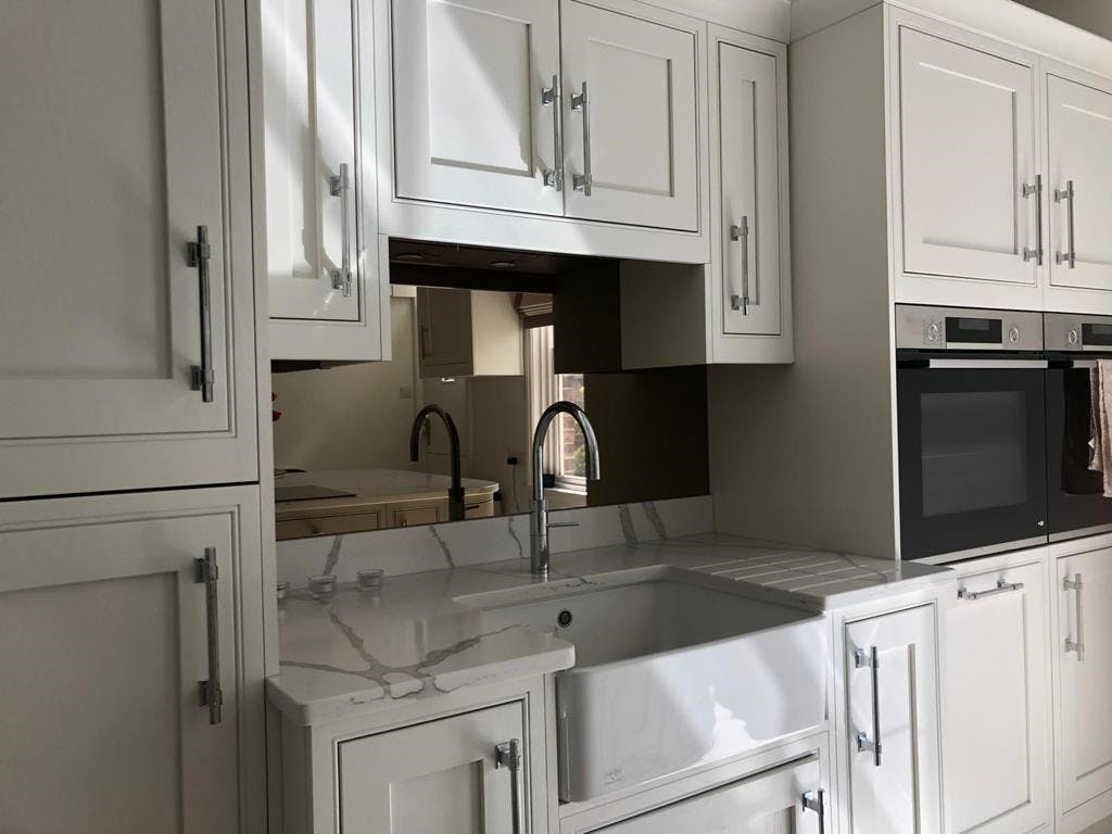 Second Nature Kitchens Clarendon In Frame, Porcelain and Cashmere With Quooker Tap and Bronze Mirror Splashback
