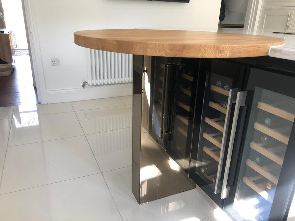 Oak Feature In Calacatta Quartz Worktop With Wine Fridge