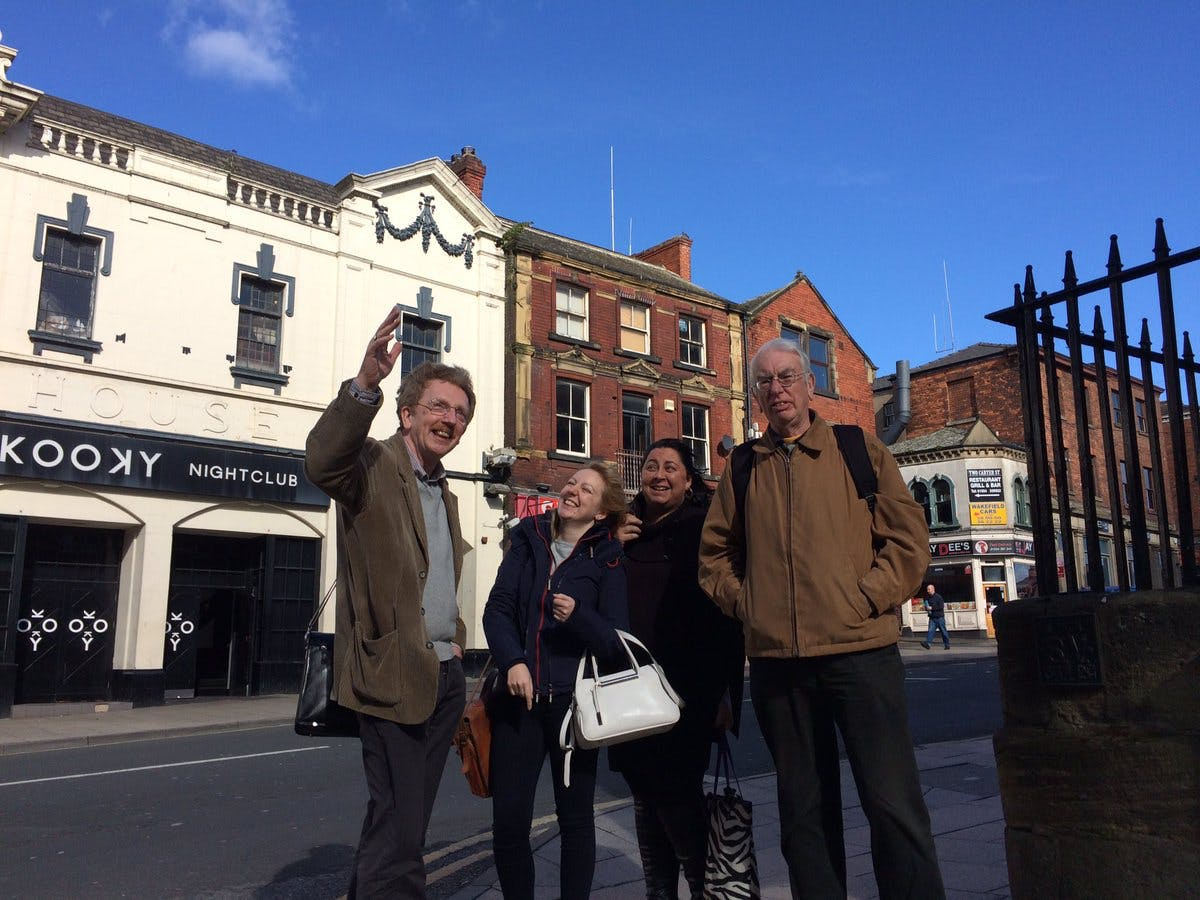 Kevin Trickett of Wakefield Civic Society showing representatives of Civic Voice around the city