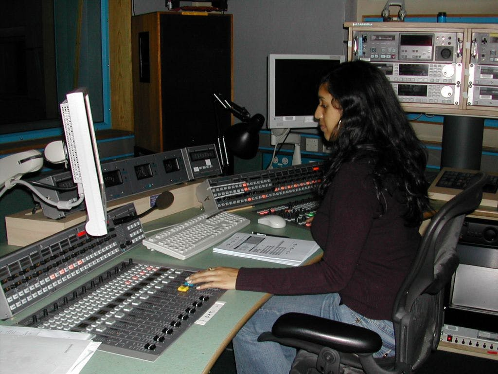 Testing a sound desk in a radio studio