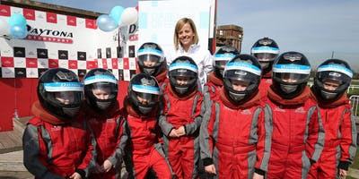 Formula 1 driver Susie Wolff  with a group of girls