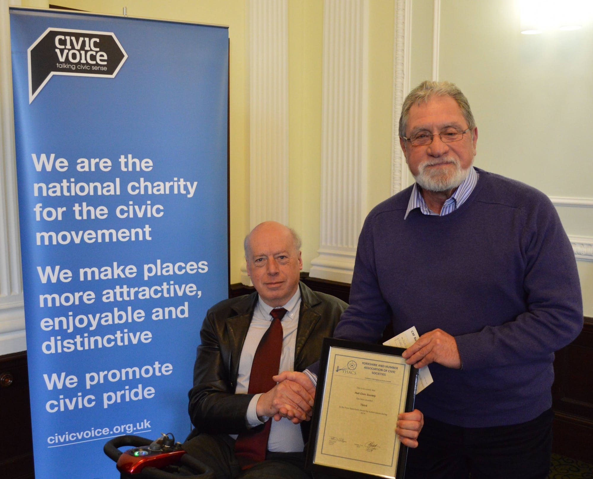 Malcolm Sharman of Hull Civic Society receiving a cheque for £50.